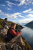 Man And Woman Looking Across Harriman Fjord Pws Southcentral Alaska Summer