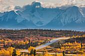 Vehicles Travel The Richardson Highway Through The Alaska Range Mountains, Interior, Alaska
