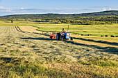 Farmer Bales Hay On A Sunny Summer Evening Along Chena Hot Springs Road, Fairbanks, Alaska.