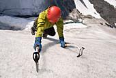 Woman Ice Climbing On Exit Glacier At Kenai Fjords National Park. Summer On The Kenai Peninsula Of Southcentral Alaska.
