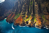 'Aerial view of the rugged coastline along an hawaiian island; Hawaii, United States of America'