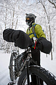 Male Bicyclist In Cold Weather Gear With His Fat Tire Snow Bike, Far North Bicentnnial Park, Anchorage, Southcentral Alsaka, Winter