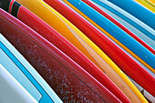 'Close up of coloured surfboards lined up; Honolulu, Oahu, Hawaii, United States of America'