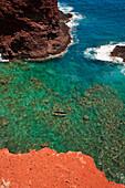 'Stand-up paddleboarding at Pu'u Pehe rock, (sweetheart rock); Lanai, Hawaii, United States of America'