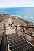 'Stairs leading down to a ridge overlooking the ocean; Honolulu, Oahu, Hawaii, United States of America'