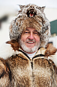 Portrait Of Man Wearing Lynx Fur Hat And Fur Coat At The Ceremonial Start Of The 2013 Iditarod Sled Dog Race In Downtown Anchorage