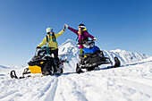 Lynsey Dyer And Sierra Quitiquit On Their Snowmobiles Ready For Some Backcountry Skiing In The Chugach Mountains, Late Winter Southcentral Alaska.