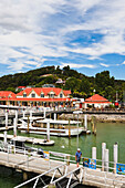 'Buildings And Boats At The Waterfront In The Port Of Paihia, Bay Of Islands; New Zealand'