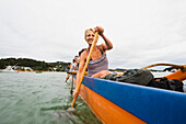 'Paddling On A Waka In The Bay Of Islands; New Zealand'