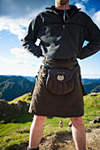 'A Man Wearing A Skirt And Pouch Around His Waist, Whanganui National Park; Whakahoro, New Zealand'