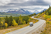 'Vehicles Travel The Winding Al-Can Highway That Connects Alaska With Canada Via Road; Yukon Territory, Canada'