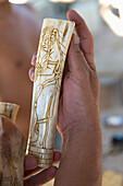 'A Hand Holds Carved Handiwork; Copan, Honduras'
