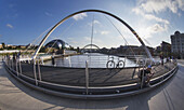 'Millenium Bridge Over River Tyne And Sage Gateshead In The Distance; Newcastle, Tyne And Wear, England'