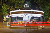 'An Amusement Park Ride Illuminated At Nighttime; Locarno, Ticino, Switzerland'