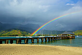 'A rainbow over Hanalei pier in Hanalei bay; Kauai, Hawaii, United States of America'