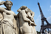 Statues of nude women in the trocadero garden, la joie de vivre 1937, made by leon-ernest drivier for the world expo, and the eiffel tower, paris, 16th arrondissement, france