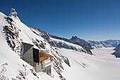 Wintry scene of the aletsch glacier and the jungfraujoch pass with the observatory nicknamed the sphinx at its summit, the jungfrau, bernese alps, canton of bern, switzerland