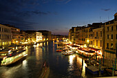 General view of the grand canal and activity on the quays at night, venice, venetia, italy