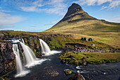 Mount kirkjufell and its waterfalls, geothermal zone of the snaefellsnes peninsula, northwest iceland, europe