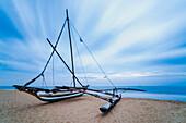 Outrigger fishing boat on Negombo Beach at sunrise, Sri Lanka, Asia