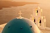 St. Gerasimos Church with blue dome at sunset, Firostefani, Santorini, Cyclades, Aegean Sea, Greek Islands, Greece, Europe
