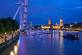 River Thames, Houses of Parliament and London Eye at dusk, London, England, United Kingdom, Europe