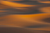 Abstract view of the desert, panning at sunrise between the high dunes of Sahara's desert, Morocco