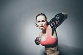 Portrait of Caucasian woman in fighting stance, Saint Louis, Missouri, USA