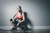 Caucasian woman in sportswear resting with water bottle, Saint Louis, Missouri, USA