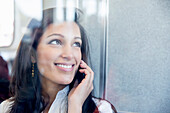 Mixed race businesswoman talking on cell phone, Seattle, WA, USA