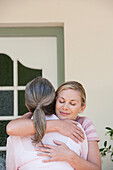 Caucasian mother and daughter hugging, Cape Town, Western Cape, South Africa