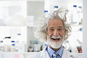 Senior Caucasian scientist with unruly hair in lab, Cape Town, Western Cape, South Africa