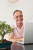 Businessman working at desk in office, Palma de Mallorca, Balearic Islands, Spain