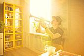 Caucasian man playing trumpet in kitchen, Nizhniy Tagil, Sverdlovsk region, Russia