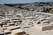Gravestones (150, 000 graves). Jewish Cemetery on the Mount of Olives with the Dome of the Rock on the Temple Mount in background. Jerusalem. Israel.