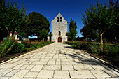 Mayrac Lot, facade of a church and its path marked trees