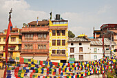 'Buildings and prayer flags on the main square; Boudhanath, Nepal'