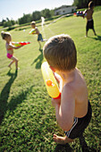 Children Playing With Water Pistols