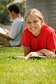 Pretty Teenage Student Reading Outdoors