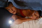 Children Hide Under Blanket