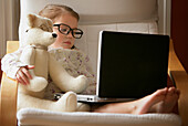 Child And Teddy Bear Hard At Work