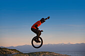 Young Man Mountain Unicycling