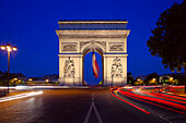 Arc De Triomphe On The Champs-Élysées At Night