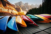 Multi-Colored Canoes Resting On A Dock
