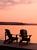 Lake Of The Woods, Ontario, Canada, Adirondack Chairs On A Dock