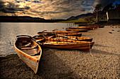 Canoes On The Shore, Keswick, Cumbria, England