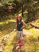 Girl Walking In Woods