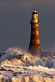 Waves Crashing Against A Lighthouse, Tyne And Wear, England