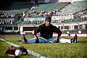 Baseball Player Stretching