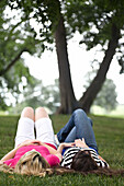 Two Girls Laying On The Grass